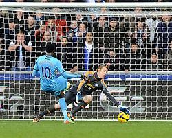 Tottenham Hotspur's Emmanuel Adebayor scores his second and tottenhams third of the game - Photo mandatory by-line: Joe Meredith/JMP - Tel: Mobile: 07966 386802 19/01/2014 - SPORT - FOOTBALL - Liberty Stadium - Swansea - Swansea City v Tottenham Hotspur - Barclays Premier League