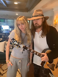 """Miley Cyrus releases a photo on Twitter with the following caption: """"""""#HannahMontana & @billyraycyrus"""""""". Photo Credit: Twitter *** No USA Distribution *** For Editorial Use Only *** Not to be Published in Books or Photo Books ***  Please note: Fees charged by the agency are for the agency's services only, and do not, nor are they intended to, convey to the user any ownership of Copyright or License in the material. The agency does not claim any ownership including but not limited to Copyright or License in the attached material. By publishing this material you expressly agree to indemnify and to hold the agency and its directors, shareholders and employees harmless from any loss, claims, damages, demands, expenses (including legal fees), or any causes of action or allegation against the agency arising out of or connected in any way with publication of the material."""