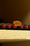 Bottles aging in the cellar. 1947. Chateau Grand Corbin Despagne, Saint Emilion Bordeaux France