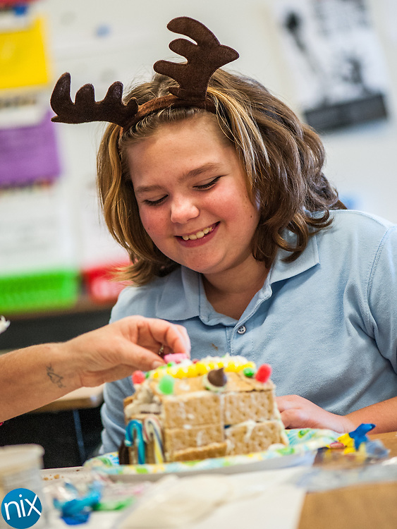 Shady Brook Elementary fourth-grader Harley Kluttz designs a gingerbread house in Alexandria Gordon's classroom Friday afternoon.