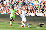 Jefferson Montero of Swansea city ®  is challenged by Jesus Navas  of Manchester city . Barclays Premier league match, Swansea city v Manchester city at the Liberty Stadium in Swansea, South Wales on Sunday 15th May 2016.<br /> pic by Andrew Orchard, Andrew Orchard sports photography.