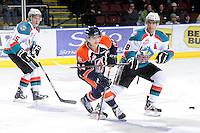 KELOWNA, CANADA, FEBRUARY 11: JC Lipon #34 of the Kamloops Blazers makes a pass while checked by Colton Sissons #15 and Brett Bulmer #19 of the Kelowna Rockets as the Kamloops Blazers visit the Kelowna Rockets on February 11, 2012 at Prospera Place in Kelowna, British Columbia, Canada (Photo by Marissa Baecker/www.shootthebreeze.ca) *** Local Caption ***