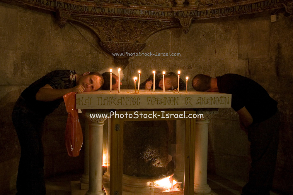 Israel, Jerusalem Old City, the Stone of Anointing at the Church of the Holy Sepulchre on Good Friday. Easter