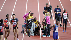 Jamaica's Usain Bolt (centre) lies injured after the Men's 4x100m Relay Final during day nine of the 2017 IAAF World Championships at the London Stadium. Picture date: Saturday August 12, 2017. See PA story ATHLETICS World. Photo credit should read: Yui Mok/PA Wire. RESTRICTIONS: Editorial use only. No transmission of sound or moving images and no video simulation.