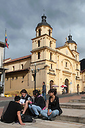 Student and church in the Candelaria district