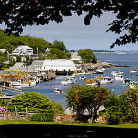 Working harbor with fleet of lobster boats anchored New Harbor Maine