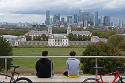 ©Licensed to London News Pictures 30/09/2020  <br /> Greenwich, UK. Two young cyclists relaxing with the view. A grey autumnal weather day today in Greenwich park, Greenwich, London. Photo credit:Grant Falvey/LNP