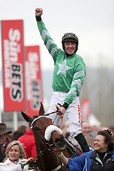 Jockey Davy Russell on Presenting Percy celebrates winning the Pertemps Network Final Handicap Hurdle during St Patrick's Thursday of the 2017 Cheltenham Festival at Cheltenham Racecourse.