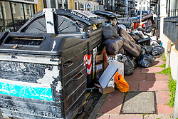 © Licensed to London News Pictures. 11/10/2021. Brighton, UK. Bins in Brighton and Hove are overflowing due to a dispute between the Green Party led council and their waste management Citiclean. A two week strike was announced resulting in uncollected rubbish pilling ip and overflowing in the streets. Photo credit: Hugo Michiels/LNP
