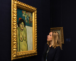 """Sotheby's, Mayfair, London, October 9th 2015. Expected to fetch up to $60,000,000 at auction, Sotheby's presents """"the finest Blue Period Picasso to come to market in a generation"""", painted in 1901 when Pablo Picasso was just shy of 20 years old. PICTURED: A Sotheby's representative admires the Picasso ahead on its auction in New York. // Contact: paul@pauldaveycreative.co.uk Mobile 07966 016 296"""