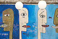Berlin, Germany (9 November 2014). Street art on a remaining section of the Berlin Wall at East Side Gallery. 9 November 2014 marks the 25th anniversary of the fall of the Berlin Wall, and on the preceding day some 8,000 large white illuminated balloons were placed along the course of the former Wall, to be released in the evening on 9 November. © Rudolf Abraham.