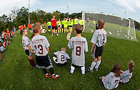 The Laconia Savings Bank team of 6-7 year olds gather at Robbie Mills Sports Complex for opening day ceremonies with the Laconia Youth Soccer program Saturday morning.  (Karen Bobotas/for the Laconia Daily Sun)