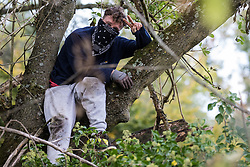 Denham, UK. 29th September, 2020. An environmental activist puts on a brave face as he observes tree surgeons working on behalf of HS2 Ltd felling trees in Denham Country Park for works connected to the HS2 high-speed rail link. Anti-HS2 activists based at the nearby Denham Ford Protection Camp and protesting against the destruction of the woodland contend that the area of Denham Country Park currently being felled is not indicated for felling on documentation supplied by HS2 Ltd.