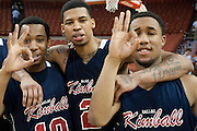 Cordel Finley (10), Keith Frazier (2) and Jordon Adams (23) of Dallas Kimball celebrate after defeating San Antonio Northside Brennan during the UIL Conference 4A semifinals at the Frank Erwin Center in Austin on Thursday, March 7, 2013. (Cooper Neill/The Dallas Morning News)