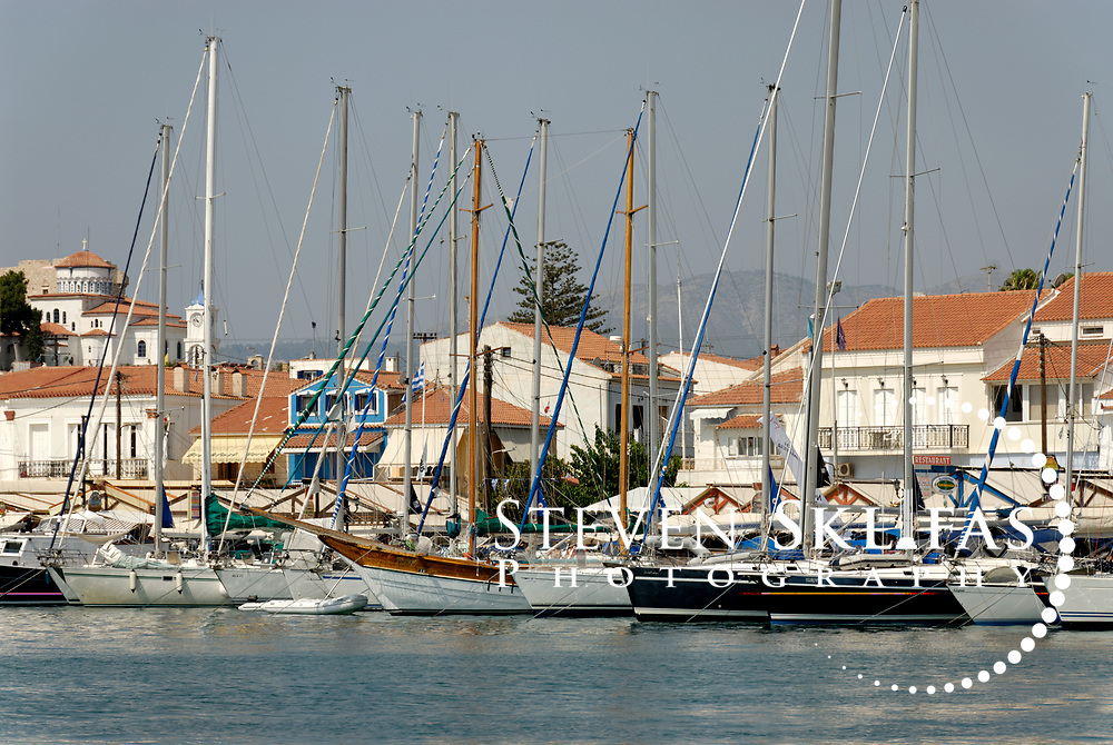 Samos. Greece.  View of sailing and fishing boats docked at the harbour town of Pythagoreio which  is the most popular and fashionable town on the island and was named after the great philosopher Pythaogaras who was born here in 580 BC.