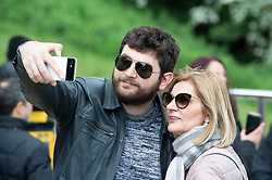 © Licensed to London News Pictures. 26/04/2019.<br /> Greenwich,UK. Taking a selfie in the park. Cloudy but bright weather today in Greenwich Park, London as storm Hannah is set to hit the UK tonight or tomorrow with winds of up to 75mph. Photo credit: Grant Falvey/LNP