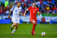 Wales midfielder Gareth Bale on the ball during the UEFA European 2020 Qualifier match between Wales and Slovakia at the Cardiff City Stadium, Cardiff, Wales on 24 March 2019.