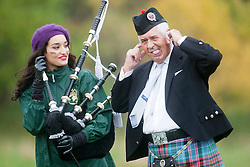 Miss India Kanishtha Dhankhar with pipe major David Boyle..The Miss World 2011 contestants take part in Highland Games in the grounds of Crieff Hydro, Perthshire..MISS WORLD 2011 VISITS SCOTLAND..Pic © Michael Schofield.