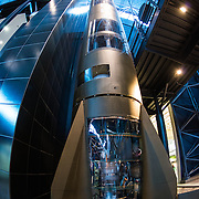 A Redstone PGM-11 nuclear missile on display at the Smithsonian National Air and Space Museum's Udvar-Hazy Center. Its design was descended from the German V-2 rocket, and it was the first U.S. missile carry a live nuclear warhead (in a 1958 test). The Redstone was in service from June 1958 to June 1964. Located near Dulles Airport, the Udvar-Hazy Center is the second public facility of the Smithsonian's National Air and Space Museum. Housed in a large hangar are a multitude of planes, helicopter, rockets, and space vehicles.