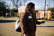UNIONTOWN, AL – DECEMBER 11, 2019: After an informational gathering, Keshee Dozier-Smith, 34, reads the name and phone number of an elderly man who stopped her in the street to express interest in the healthcare services offered by Rural Health Medical Program.<br /> <br /> Since joining Rural Health Medical Program as Chief Executive Officer in March 2016, Dozier-Smith has effectively moderned the 35-year-old floundering business – opening three new clinics, streamlining processes and reaching out to local companies to offer healthcare services for employees. In the wake of rising hospital closures that leave Alabama's poorest citizens disproportionately cut off from access to medical care, Dozier-Smith represents a renewed effort to bridge the rural gap by offering a quality, affordable healthcare option.