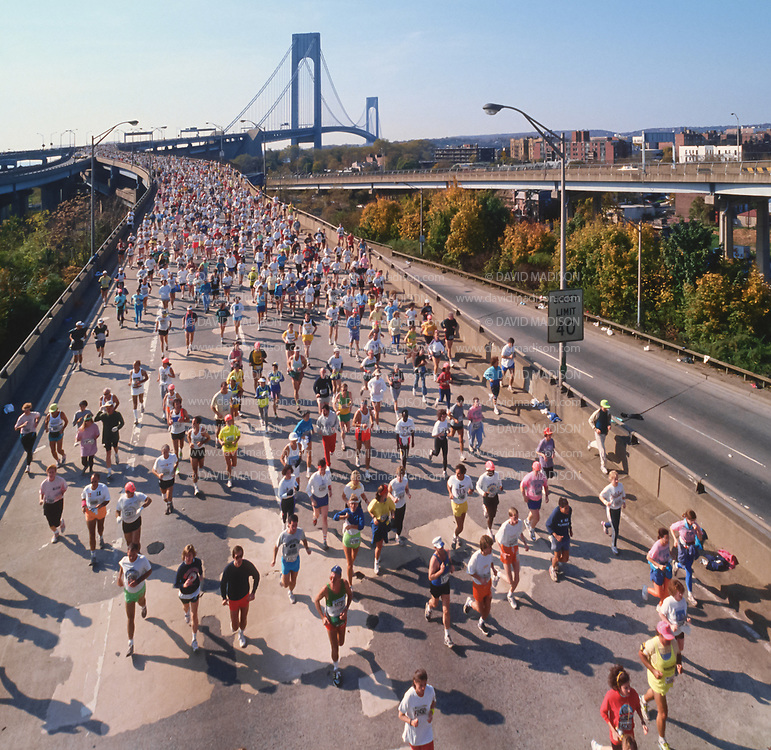 NEW YORK - NOVEMBER 3:  Runners competing in the 1991 New York City Marathon exit the Verrazzano Bridge from Staten Island into Brooklyn near the beginning of the race on November 3, 1991 in New York, New York.  (Photo by David Madison/Getty Images)