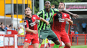 Tom Elliott holds of Luke Rooney and Simon Walton during the Sky Bet League 2 match between Crawley Town and AFC Wimbledon at the Checkatrade.com Stadium, Crawley, England on 15 August 2015. Photo by Michael Hulf.