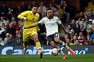 Ryan Fredericks (Right) of Fulham clearing the danger whilst under pressure from Daniel Powell (Left) of Milton Keynes Dons Skybet football league championship match, Fulham  v Milton Keynes Dons at Craven Cottage in London on Saturday 2nd April 2016.<br /> pic by Steffan Bowen, Andrew Orchard sports photography.