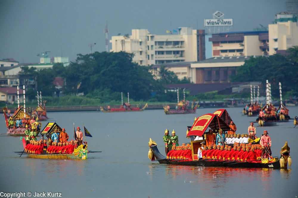 06 NOVEMBER 2012 - BANGKOK, THAILAND:  The Dang Barge Thong Kwan Fa leads the Royal Barge Procession rehearsal on Chao Phraya River in Bangkok. The barge is crewed by 38 oarsman, 1 officer, 2 steers men and a signalman. Thailand's Royal Barge Procession has both religious and royal significance. The tradition is nearly 700 years old. The Royal Barge Procession takes place rarely, typically coinciding with only the most important cultural and religious events. During the reign of King Bhumibol Adulyadej, spanning over 60 years, the Procession has only occurred 16 times. The Royal Barge Procession consists of 52 barges: 51 historical Barges, and the Royal Barge, the Narai Song Suban, which King Rama IX built in 1994. It is the only Barge built during King Bhumibol's reign. These barges are manned by 2,082 oarsmen. The Procession proceeds down the Chao Phraya River, from the Wasukri Royal Landing Place in Bangkok, passes the Grand Palace complex and ends at Wat Arun. Tuesday's dress rehearsal was the final practice for the 2012 Royal Barge Procession, which takes place November 9.  PHOTO BY JACK KURTZ