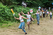 A group of very excited Jeremy Corbyn fans charge out of the Faraway Forest chanting Ohhhh Jeremy Corbyn - The 2017 Latitude Festival, Henham Park. Suffolk 16 July 2017