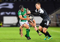 Ian McKinley of Benetton Treviso is evades the tackle of George North of Ospreys<br /> <br /> Photographer Craig Thomas/Replay Images<br /> <br /> Guinness PRO14 Round 4 - Ospreys v Benetton Treviso - Saturday 22nd September 2018 - Liberty Stadium - Swansea<br /> <br /> World Copyright © Replay Images . All rights reserved. info@replayimages.co.uk - http://replayimages.co.uk
