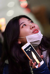"Proteste gegen Park Geun-hye in Seoul / 101216<br /> <br /> ***A woman takes part in a rally against the president, with a smartphone showing a candle and the slogan ""Catch Park Geun Hye,"" in Seoul on Dec. 10, 2016, a day after parliament voted to impeach President Park over an influence-peddling scandal. ***"