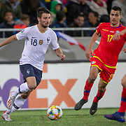 ANDORRA LA VELLA, ANDORRA. June 1. Leo Dubois #18 of France defended by Joan Cervos #17 of Andorra and Max Llovera #20 of Andorra during the Andorra V France 2020 European Championship Qualifying, Group H match at the Estadi Nacional d'Andorra on June 11th 2019 in Andorra (Photo by Tim Clayton/Corbis via Getty Images)