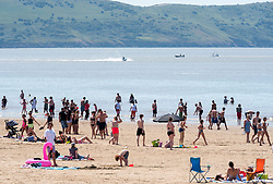 © Licensed to London News Pictures;30/05/2020; Weston-super-Mare UK. People enjoy hot sunny weather on the beach and promenade at the seaside in Weston-super-Mare, on the last weekend before some more restrictions under the coronavirus lockdown are to be eased by the Government. From Monday groups of up to 6 people from different households will be able to meet outside but must maintain social distancing to prevent the spread of the Covid-19 virus. There has been an outbreak of Covid-19 at Weston General Hospital which has now been traced to an accommodation block inside the hospital grounds. The outbreak had been blamed on visitors to Weston coming from outside the area. Photo credit: Simon Chapman/LNP.