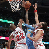 08 November 2010: Denver Nuggets' small forward #15 Carmelo Anthony goes to the basket against Chicago Bulls' forward #22 Taj Gibson and Chicago Bulls' center #13 Joakim Noah during the Chicago Bulls 94-92 victory over the Denver Nuggets at the United Center, in Chicago, Illinois, USA.