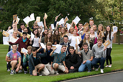 © Licensed to London News Pictures.22/08/2013. Solihull, West Midlands, UK. Solihull School achieved outstanding GSCE Level Results this year, up on previous years, with 10 pupils alone sharing 100 A Stars between them. Pictured, pupils celebrate with headmaster David Loyd. Photo credit : Dave Warren/LNP