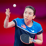 TOKYO, JAPAN - JULY 24: Juan Liu of the United States in action against Olufunke Oshonaike of Nigeria in the Women's Singles  Preliminary Round in the Tokyo Metropolitan Gymnasium at the Tokyo 2020 Summer Olympic Games  on July 24, 2021 in Tokyo, Japan. (Photo by Tim Clayton/Corbis via Getty Images)
