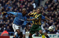 Copyright Sportsbeat. 0208 3926656<br />Picture: Henry Browne<br />Date: 1/02/2003<br />Manchester City v West Bromwich Albion FA Barclaycard Premiership<br />Ronnie Wallwork of West Brom and Nicolas Anelka of Man City look on as Marc Vivien Foe's shot goes in