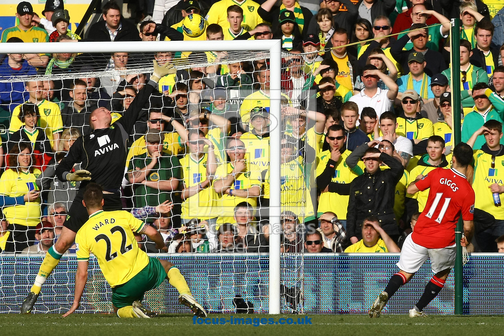 Picture by Paul Chesterton/Focus Images Ltd.  07904 640267.26/02/12.Ryan Giggs of Man Utd hits the bar during the Barclays Premier League match at Carrow Road Stadium, Norwich.