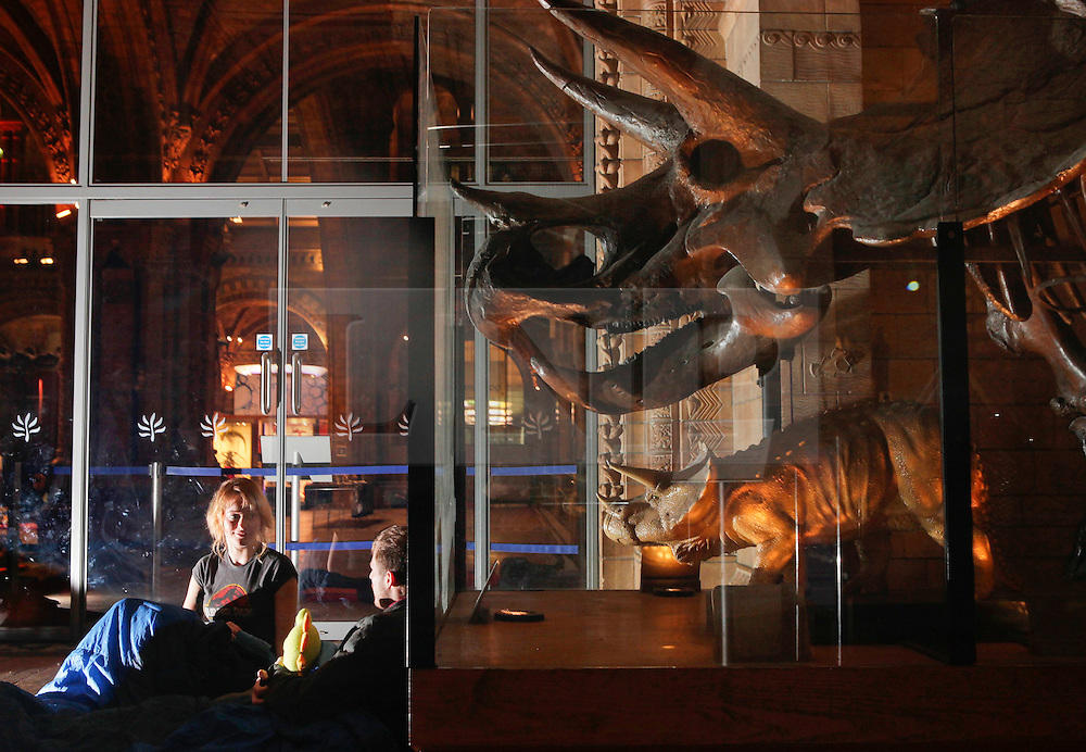 Natural History Museum, London, UK. 17/01/2014<br /> Indi Heath and Howard Sivills, from London, settle down for the night by an exhibit of dinosaur Triceratops, in the Natural History Museum in London. The 'Dino Snore' sleepover event allowed paying adults to spend the night inside the museum, where people could sleep among the dinosaur exhibits along with activities such as eating edible bugs and a lecture on the sex lives of insects.<br /> Photo: Anna Branthwaite/LNP