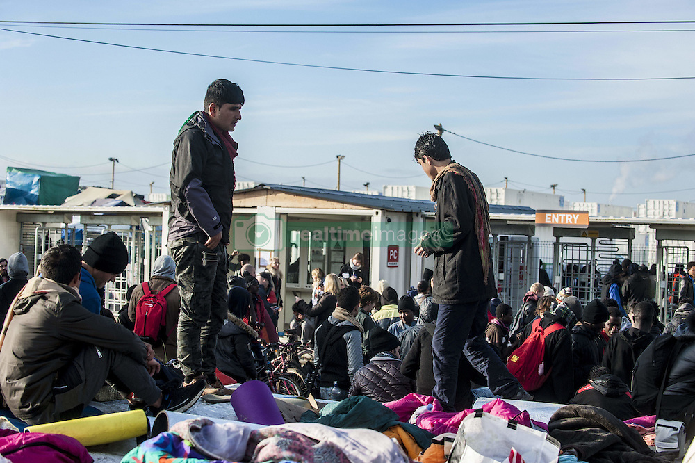 October 27, 2016 - Calais, France - The youngest refugees waiting at the Welcome Centre Provisional being supported by France, Calais, 27 October 2016..The Calais jungle begins its fourth day of dismantling. Most refugees have left the jungle. Some roam the jungle and over 100 young refugees have no place in the Provisional Home Centre. The workers are destroying the jungle growing rapidly. (Credit Image: © Julien Pitinome/NurPhoto via ZUMA Press)