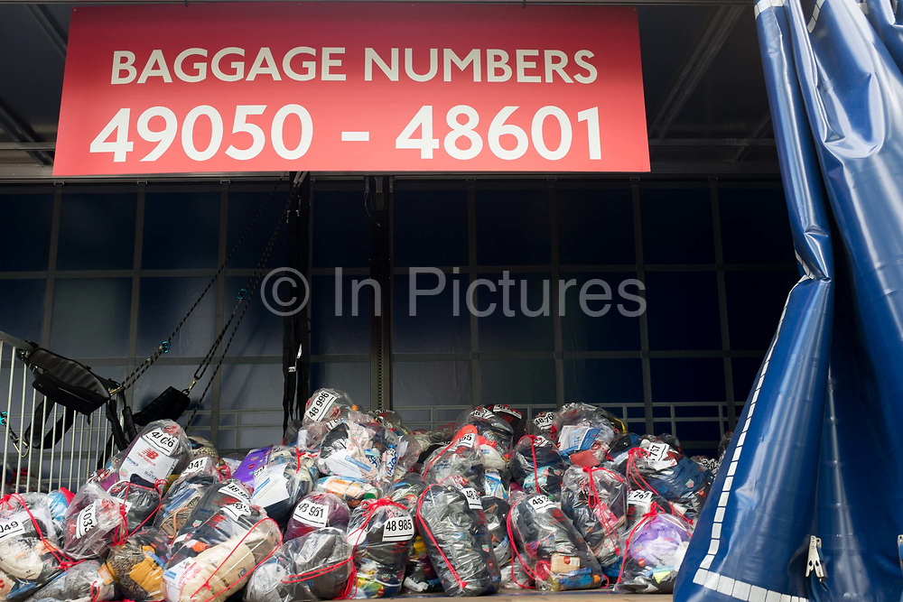 Local London park run volunteers loaded runners bags into the lorries in Greenwich Park before the start of the 2019 London Marathon, on 28th April 2019, in London, England.