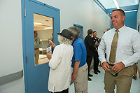 Elaine Morrison, Dick Smith and Lieutenant Kris Kelley tour the Men's Wing of the Belknap County Corrections Facility following their grand opening Thursday afternoon.  (Karen Bobotas/for the Laconia Daily Sun)