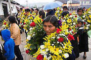 Men, women and children carry large bouquets of flowers in procession through the rain to their church during the patron saint festival at San Pedro Chenalho, a Tzotzil Mayan village outside San Cristobal de las Casas, Chiapas, Mexico on June 27, 2008.