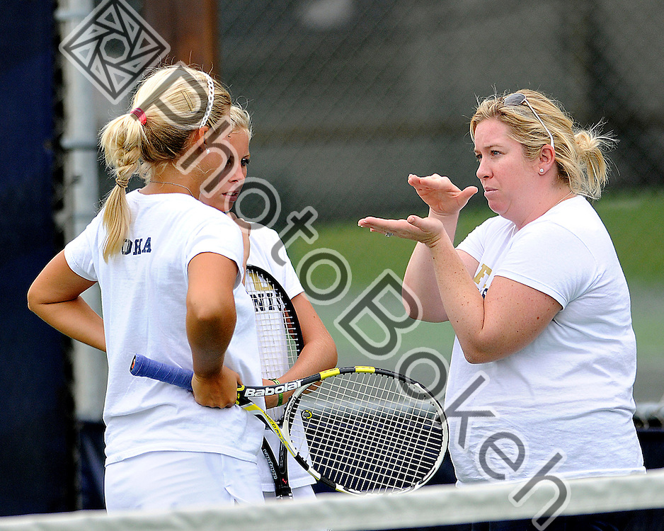 2011 October 15 - FIU's Karyn Guttormsen and Giulietta Boha meeting with head coach Melissa Applebaum-Dall'au. Florida International University Golden Panthers hosted the 2011 Panther Invitational at the FIU Tennis Courts, Miami, Florida. (Photo by: www.photobokeh.com / Alex J. Hernandez) 1/2000 f/2.8 ISO400 450mm
