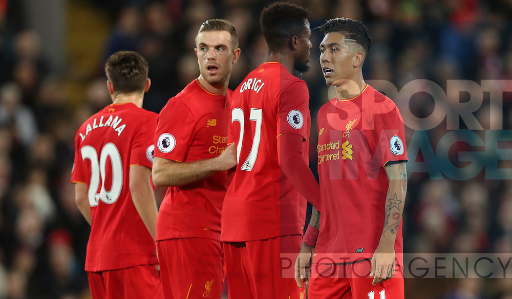 Adam Lallana, Jordan Henderson, Divock Origi and Roberto Firmino of Liverpool during the Premier League match at Anfield Stadium, Liverpool. Picture date: December 11th, 2016.Photo credit should read: Lynne Cameron/Sportimage