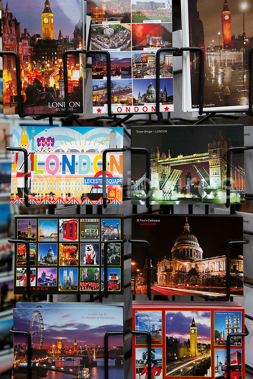 Postcards depicting classic sights for sale at a souvenir shop in central London.