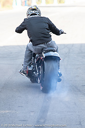 Stunt rider Chris Pfeiffer racing a Harley-Davidson in the 1/8 mile sprint races during the Intermot International Motorcycle Fair. Cologne, Germany. Saturday October 6, 2018. Photography ©2018 Michael Lichter.