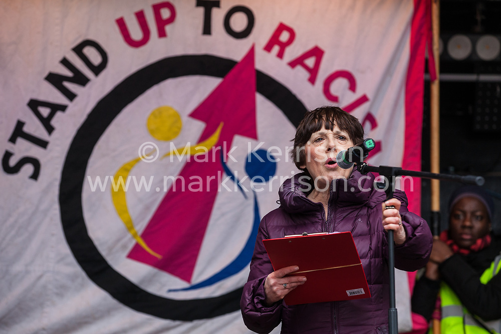 London, UK. 16th March, 2019. Dr Edie Friedman of the Jewish Council for Racial Equality (JCORE) addresses thousands of people on the March Against Racism demonstration on UN Anti-Racism Day against a background of increasing far-right activism around the world and a terror attack yesterday on two mosques in New Zealand by a far-right extremist which left 49 people dead and another 48 injured.