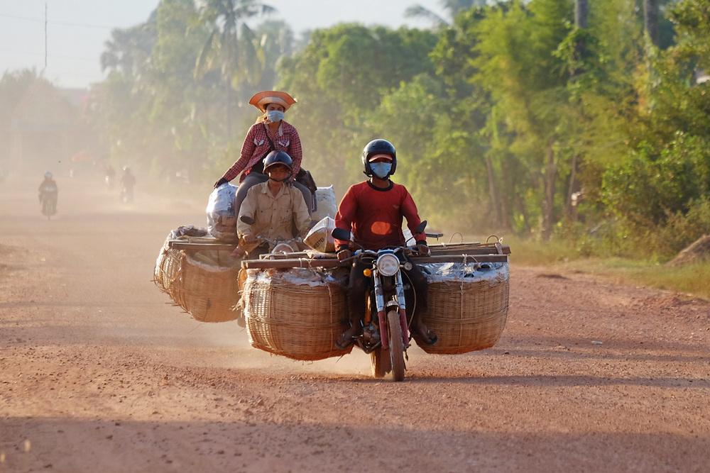 Transportation of fruit in Cambodia. <br /> Photo by Lorenz Berna