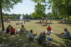 © Licensed to London News Pictures. 23/06/2020. London, UK. Members of public are seen relaxing in the sun in Victoria Park, east London. Key to easing the lockdown in England will be the two-meter rule - the distance people should stay apart to stop catching coronavirus. Photo credit: Marcin Nowak/LNP